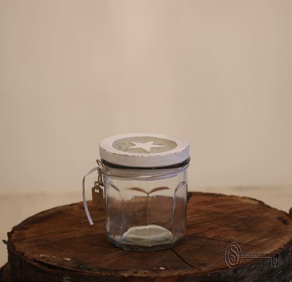 Bild von Glas mit Sternendeckel aus Beton