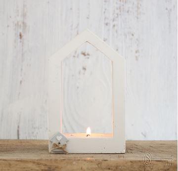 Bild von Betonhüsli mit Kerzenlicht